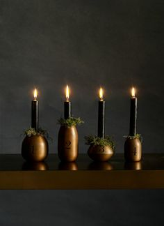 Dark elegance in black and bronze. The wood candle holders and moss give these Advent candles a natural warmth, but the color scheme will fit any upscale home. Advent Candles, Candles And Candleholders, Candlesticks, Copper Candle Holders, Candlestick Holders, Copper Home Accessories, Traditional Design, Decoration, Color Schemes