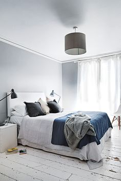 """Master bedroom """"Grey is a lovely neutral – it adds depth and works very well with our painted floor,""""..."""