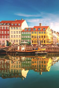 Nyhavn is a 17th-century waterfront, canal and entertainment district in Copenhagen, Denmark. Stretching from Kongens Nytorv to the harbour front just south of the Royal Playhouse, it is lined by ...