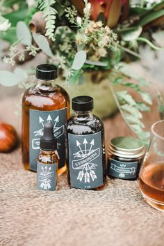 Wedding Guest favors - Manhattan Kit - By Kitsy California on Etsy - Bourbon Vermouth Bitters and Cherries - doe hide - pipe - feathers and arrow heads - leather - corks ~ Styled by Wright Event Services Photography: Andrea Pesce Photography - www.andreapesceph... Read More: www.stylemepretty...