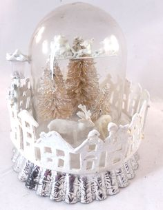A Winter Wonderland tucked inside a glass cloche. I set the stage with two vintage sugar coated deer in the fluffy snow. Three glittered