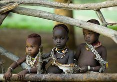 Africa | People.  Three children in Africa.  The contrast with the colours from their jewellery is fantastic.