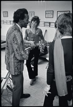 Chuck Berry and Keith Richards and Mick Jagger, 1969. That's rock 'n roll in a nutshell right there.