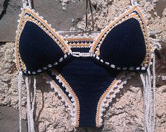 DESIGN RIGHTS BELONG TO DRAGANA - GOODMOODCREATIONS. PLEASE RESPECT. 100% high quality cotton yarn with sea shells.  This Crochet Bikini is made to order and therefore can be customized to fit your size. Item is shown in color red and size M Top/S Bottom (cup 34C). You can mix and match tops and bottoms, ties and sizes, that suits you the best.  The Bikini (both top and bottom) doesnt require lining because it is very dense in stitches.  For further information please contact me.