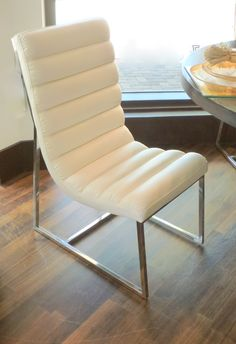 Versatile channel stitch leather chairs with chrome base works around a dining table and as pull up chairs for extra seating. Special pricing for a group of Leather Chairs, Barcelona Chair, Stitching Leather, Extra Seating, Accent Chairs, Chrome, Channel, Dining Table, Base