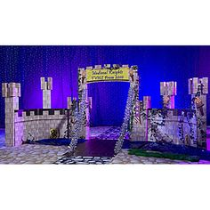Our exclusive Knights of Camelot Castle Prop features a drawbridge and stone castle walls. Each cardboard Camelot castle prop measures an astounding 8 feet 1 inch high.