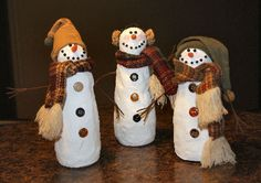 Snowmen made out of coffee creamers  and drywall compound  By Patricia