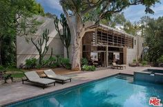 """Studio Exec's 1987 Lair on Errol Flynn Ranch Wants $4.25M  Location: Los Angeles, Calif. Price: $4,250,000 The Skinny: Located on the grounds of the San Fernando Valley's former Errol Flynn ranch, this 1987 residence was meant to be one of four homes on the Australian actor's subdivided property. Designed by Philip John Brown, the architect who masterminded Dick Clark's Flintstones-style SoCal retreat, Flynn Ranch's """"House A"""" was one of only two homes to actually be built according to the…"""