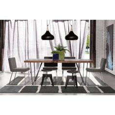 The Dylan dining table from #cb2 is another wood-top dining table. $999.00.