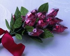 So EASY to make for Valentine's Day! Hershey Kiss Roses - Frugal Homemade Gifts at BetterBudgeting