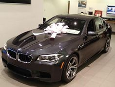 Just got a brand new 2014 BMW M5 in the showroom! It's gift wrapped & ready to go!