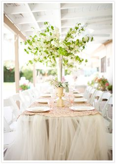 Allison, tulle table linens- gives it a softer, whimsical touch.  Thought this was cool but it might be to much for what your going for.