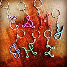 All new colors!! Handmade wire key chains in the letter and color of your choice. Make great little gifts :) sunnydaycraftsco.etsy.com