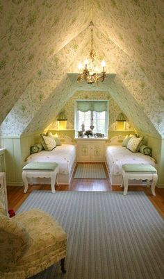 Love this attic bedroom with paper all around - oh so cozy!