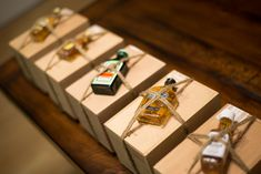 Cute idea for a couples' shower for a wedding favor inspiration: these boxes contain shaving kits with little bottles tied onto the box. For women: boxes with perfumes on top.