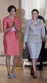 U.S. first lady Michelle Obama walks with Graca Machel, the wife of former South African President Nelson Mandela, as she visits the Nelson Mandela Foundation in Johannesburg - June 21, 2011.