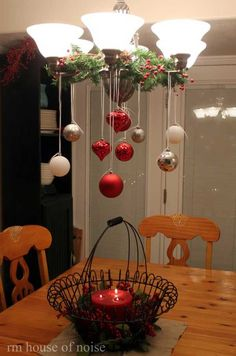 Decorating chandelier above the dining table. - 36 Creative DIY Christmas Decorations You Can Make In Under An Hour