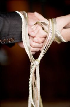 Apparently it's called 'handfasting,' and started as an ancient Celtic tradition that was continued in Scotland and other European countries, but i LOVE the symbolism it states, and LOVE the choice of lace and ribbons in this picture :] (any religion it would have a nice meaning to it)