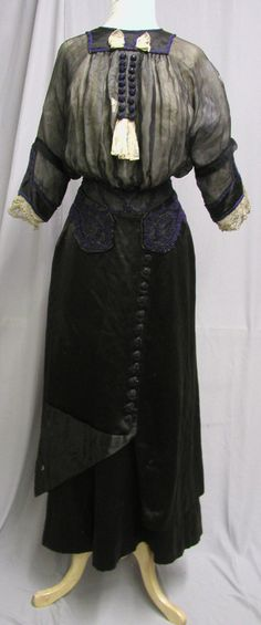 This lovely Edwardian silk and beaded gown was created around 1910 and was for sale at Bergdorf & Goodman.  Materials: Black silk chiffon,  cobalt glass beads, beaded buttons. Front
