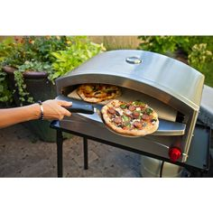 Enjoy true artisan style pizza on your own patio with the portable Italia Artisan Pizza Oven. Specially designed to work and cook like a stone fire pizza oven. This small pizza oven will have you craving pizza all the time. Best Outdoor Pizza Oven, Portable Pizza Oven, Outdoor Bars, Small Pizza, Four A Pizza, Pizza Party, Pizza Legal, Pizza Cool, Pizza Pizza