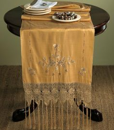 "Hand Beaded and Embroidered Floral Table Runner w/ Macrame Tassels. Butterscotch Color. 20""x90"" Rectangular. by Fennco. $39.99. Butterscotch color. Excellent Handcraftship. Measures 20 inch by 90 inch. Made of polyester. Dry clean; imported. Hand beaded and embroidered runners with macramé tasseled border. Made of polyester. Dry Clean."
