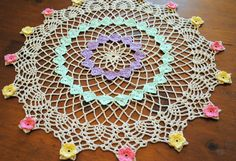 Crochet Easter egg doily with flowers, pastels, ecru, light purple, light green, pink, pale yellow, spring doily
