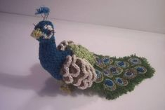 This is so adorable! Crochet peacock- the instructions aren't great, but it is a great idea!