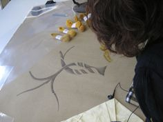 The artist next transfers the drawing on to the cotton canvas. Image courtesy The Royal School of Needlework, London.