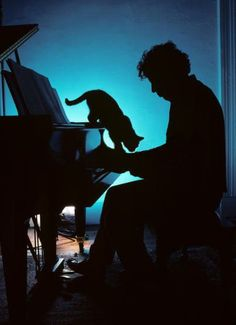 I love this silhouette of composer Philip Glass, his piano, and his cat.
