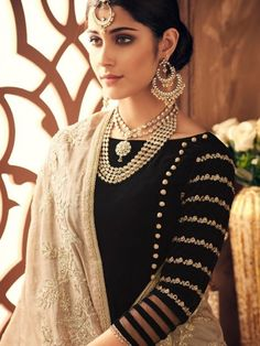 Black And Cream Embroidered Designer Anarkali Suit is especially crafted for showcasing glamorous style and ethnic elegance with its unique embroidered combination of beautiful thread work annotated on flared velvet anarkali top with border detail. Designer Salwar Kameez, Designer Anarkali, Kurti Sleeves Design, Sleeves Designs For Dresses, Neck Designs For Suits, Pakistani Dresses Casual, Pakistani Dress Design, Pakistani Bridal, Indian Dresses