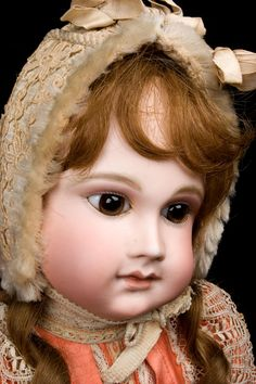 Close up of antique french doll by Schmitt