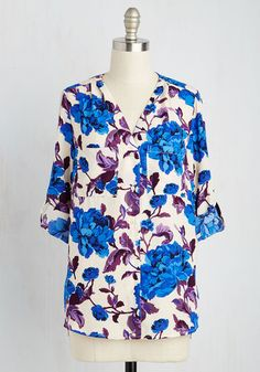 By highlighting your peppy personality with this bold button up, you'll hold ownership of everyone's attention! Slip into the lush cobalt and violet floral print and ruched shoulders of this breezy ivory blouse, and your mood will rise right along with this top's compliment count!