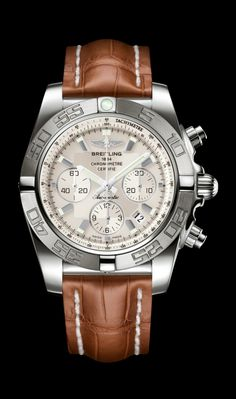 Limited Edition Chronomat 44 diver's watch by Breitling - 18K white gold case, Sierra silver dial, brown croco strap.