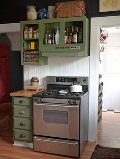 functional cabinets for oils and spices. I don't like the color, but the layout is good.