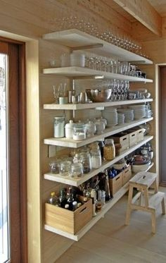 I know: open shelving is a little contentious. Some love it, while others decry it as a messy grease-and-dust magnet. That may be true in certain cases, but there's something very appealing (at least to me) about floor-to-ceiling versions, in particular, as opposed to one or two shelves hung above the sink. Here's why: