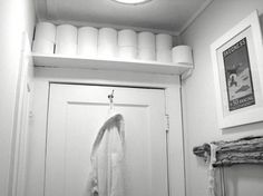 """""""Space above the door could be a bonus spot. You could also run open shelving above your vanity mirror or the full length of just about any wall as long as it is high enough so that you won't bang your head. Toilet paper or rolled-up towels can be stored attractively in this way."""""""