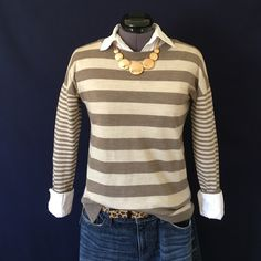 Banana Republic Merino Wool Sweater Beautiful Colors! Light brown and tan stripes, drop shoulder, crew neck but has a cute crossover design at the shoulder seams, see pic #2. Split hem, & long sleeves. 100% Merino Extra Fine Wool, & it's Super Soft! Not scratchy at all like some wools can be. Size XS. Bust measured flat across is approx. 18 inches. Back of neck to hem is 24 inches. It has a slightly looser fit to it. It's in Perfect Condition with No wear or tear or flaws. Banana Republic…