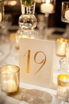 Hand-painted gold calligraphy table numbers