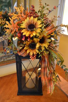 Its almost time to start thinking about fall! Dress up your lantern with a pretty fall swag. It is full of beautiful fall flowers,berries and ribbon. This swag attaches to your own lantern and does not include the lantern pictured. The arrangement is attached to the ribbon and simply ties around the top of the lantern. This swag is attached to a 20 inch lantern but could be used on another size. It measures approx. 11x18. I reccomend using a battery opperated candle inside the lantern.