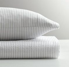 RH baby&child's Classic Stripe Crib Fitted Sheet:Beloved for its light weight and superior softness, our cotton muslin fitted sheet and pillowcase are also naturally breathable. Each piece is washed for cozy comfort, and then printed with a simplified – and aptly sized – take on classic mattress ticking.
