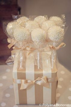 Elegant cream cake pops with scattered white sprinkles for this Little Lamb Baptism. See more party ideas at CatchMyParty.com