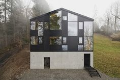 Haus Hohler by Jochen Specht, house, architecture, black siding, asymmetrical windows, concrete base