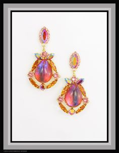 Fabulously unusual Women's drop earrings featuring vintage lava glass cabochons surrounded by vintage Swarovski stone in Astral Pink, Siam Ruby AB, Topaz and Rose...   Made by Bryan Greenwood of Crystal Countess / Jewellery by Greenwood Design
