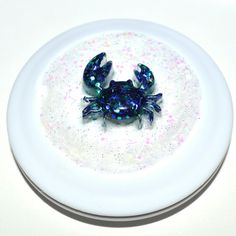 Blue crab.  https://www.etsy.com/listing/191393760/blue-crab-glamour-girl-compact-mirror