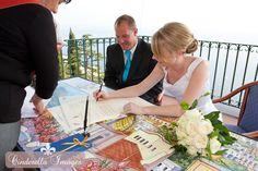 Signing the Wedding Certificate at a Civil Wedding at Positano Town Hall in Positano Italy, by Destination Wedding Photographer Anna Nersesyan - Cinderella Images