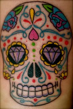 Candy skull tattoo, mexican skull tattoo (Don't really care for the tattoo-played out-but the colors are beautiful.)