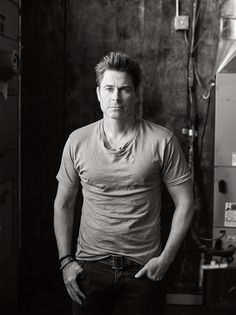 Rob Lowe embraces a relaxed aesthetic in a Kelly Cole t-shirt and Prada denim jeans.