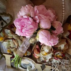 Beautiful pink peony wedding bouquet, vintage style, with burlap, lace and pearls. Visit my fb page : https://m.facebook.com/profile.php?id=900061196722049