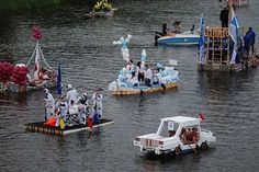wat a creative way to recycle waste things boats made out of cartoons n racing among all boats interesting ha