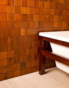 wow, what a great idea. Instead of cutting down perfectly good trees, the manufacturer reclaims and salvages old barn wood and cabinet scraps to make its line of Re-Grained decorative wood tiles. Tiles are available in such species as alder, cherry, hickory, and walnut, and measure 2 inches by 6 inches, 2 inches by 2 inches, and 4 inches by 4 inches. http://eandstile.com